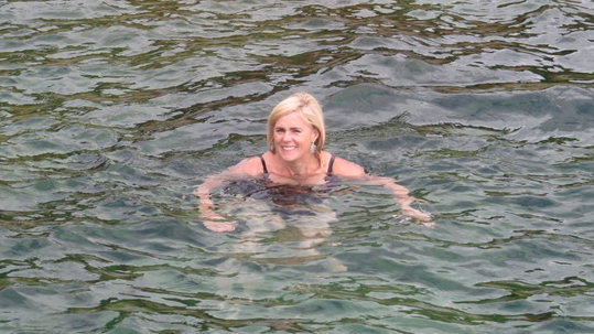 Wild swimmer and author of The Wide, Wide Sea, Anna Wilson, swimming in the sea